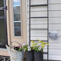 Farmhouse Porch - Add an Amish ladder, boots and water can planter for some instant charm!