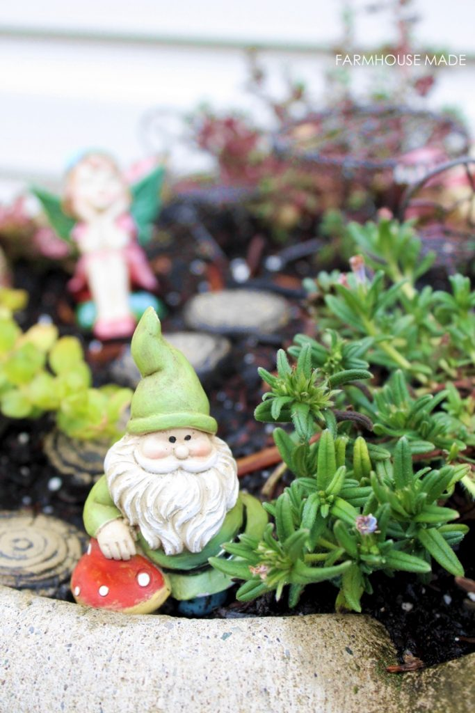 This DIY Fairy Garden made from a salvaged bird bath is simply adorable! I love the stepping stones and ladder! My kids would love this, making it for sure!