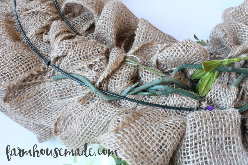 Attaching flowers to this wreath couldn't be simpler! Learn how to make a burlap wreath!