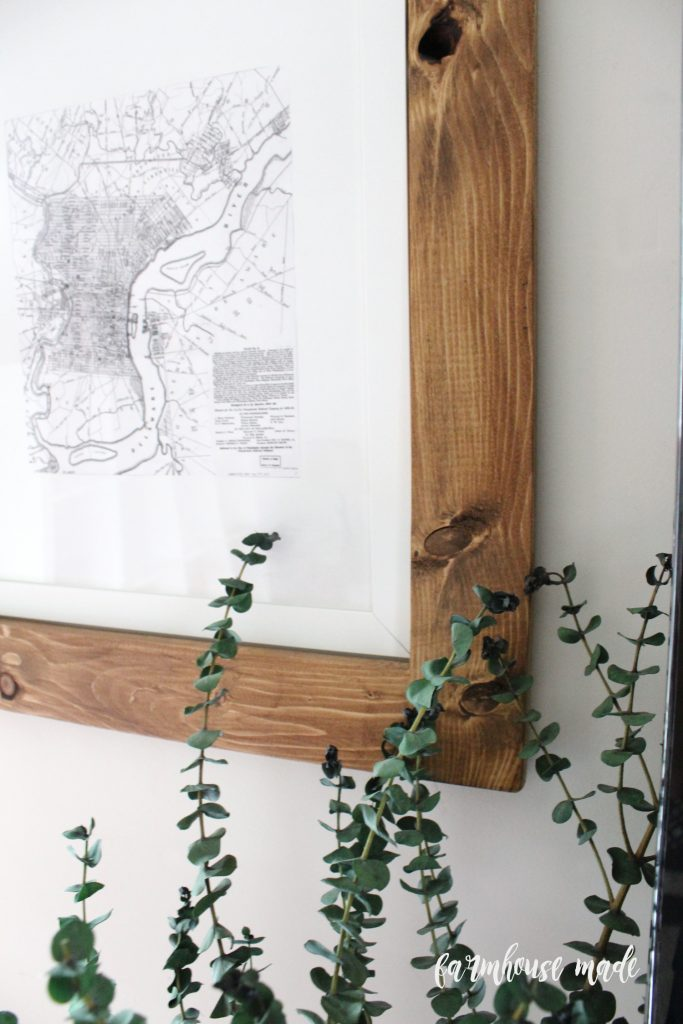 Awful with gallery walls? Me too. Give it up and go simple with this idea to decorate around a giant tv with wood frames and maps!