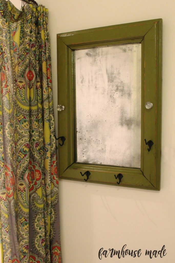 I made this chippy farmhouse mirror from a 1977 framed mirror!