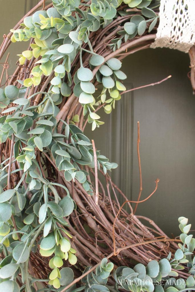 Make this adorable spring wreath in under 5 minutes! This eucalyptus garland fits perfectly around the grapevine garland wreath, and is fresh for spring!#wreath #springwreath #diywreath