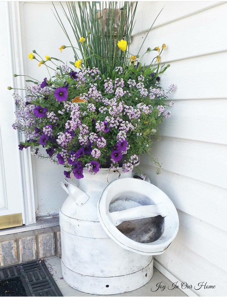 Joy In Our Home has an amazing milk can planter! This is so beautiful and makes a unique container for your flowers!