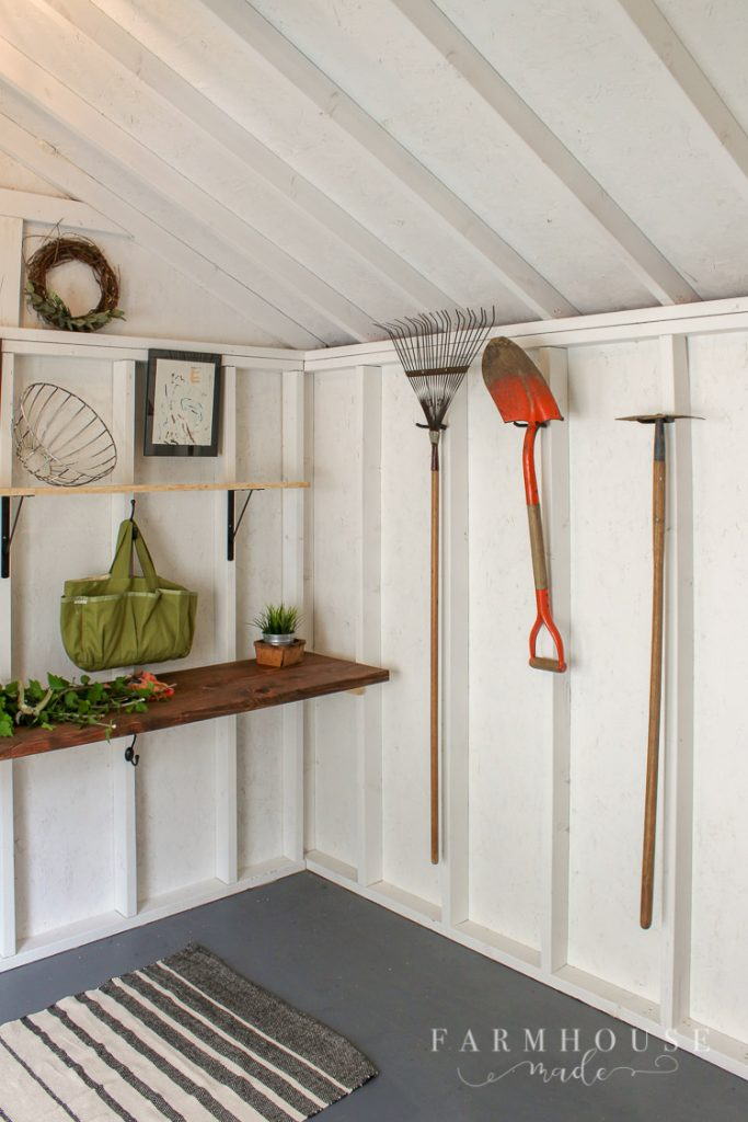 A she shed makeover that is truly amazing! This shed began as dark and dusty, and is now functional, light, bright, airy, and rich in utility storage!