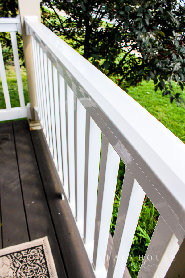 White vinyl railing that's just been steam cleaned in preparation for fall decorating