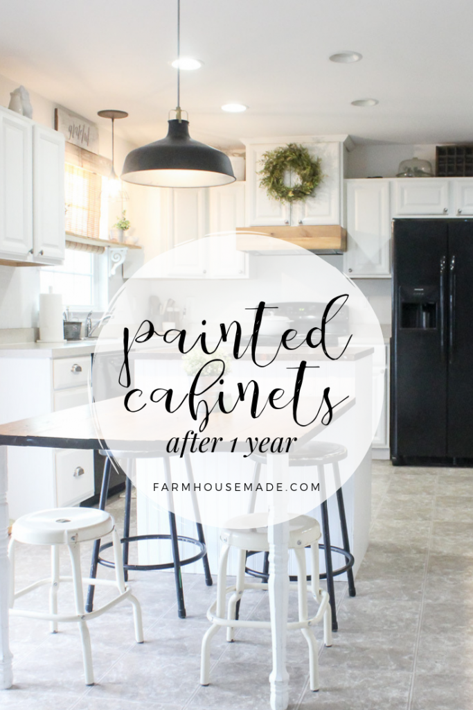 White farmhouse kitchen cabinets that were painted a year ago