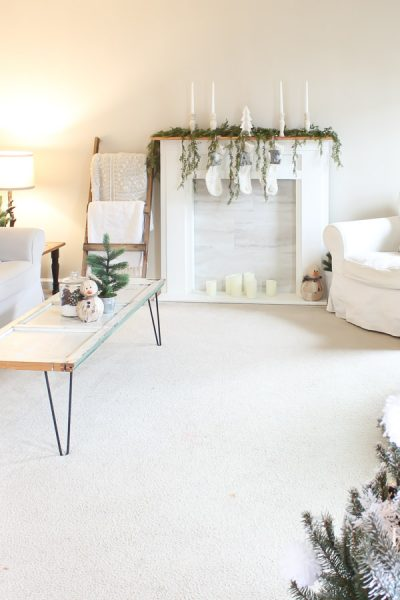 farmhouse living room with christmas decor and diy faux fireplace