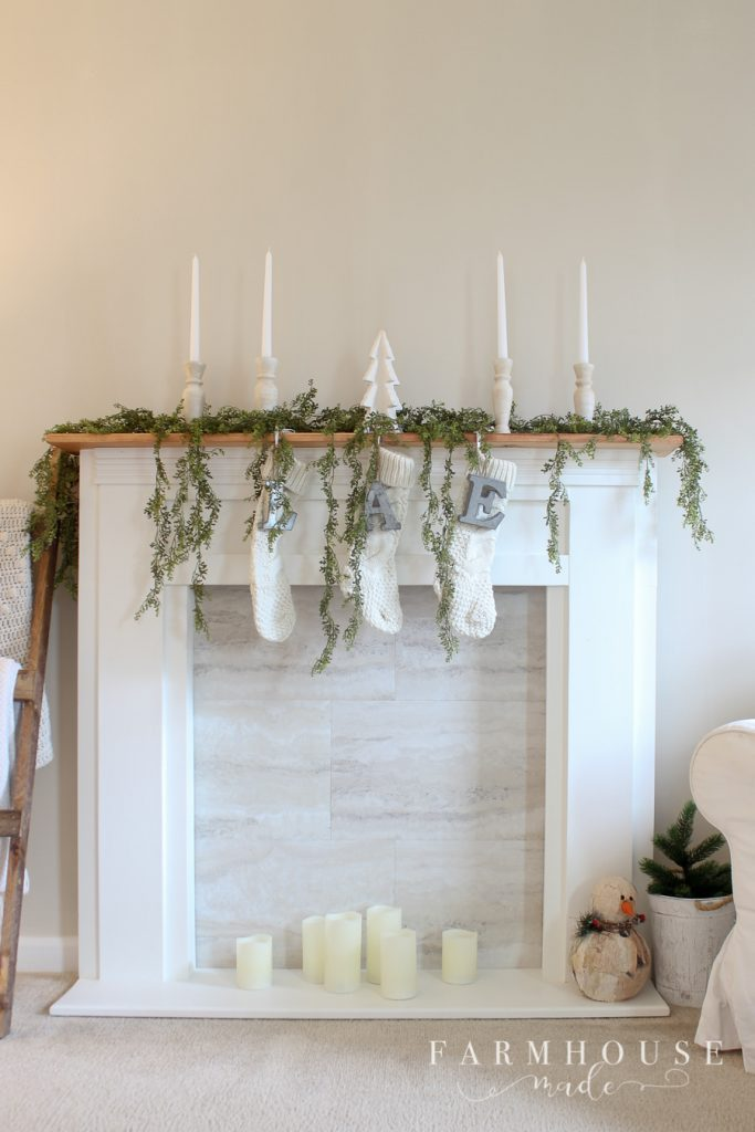 farmhouse style christmas mantle on a diy faux fireplace