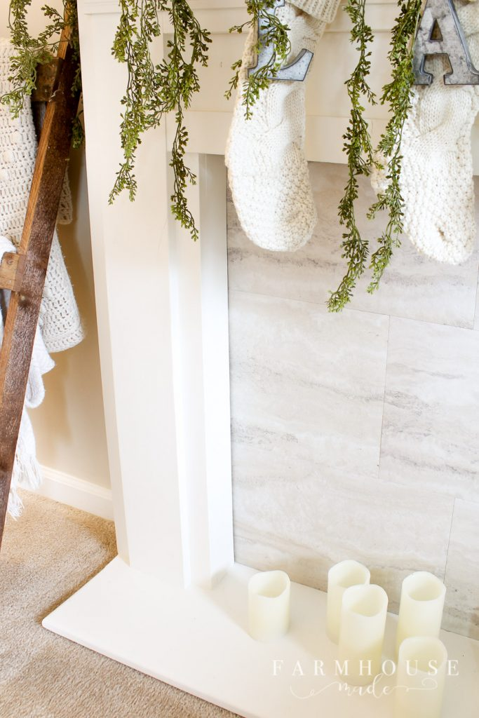 gorgeous stockings hung on diy faux fireplace