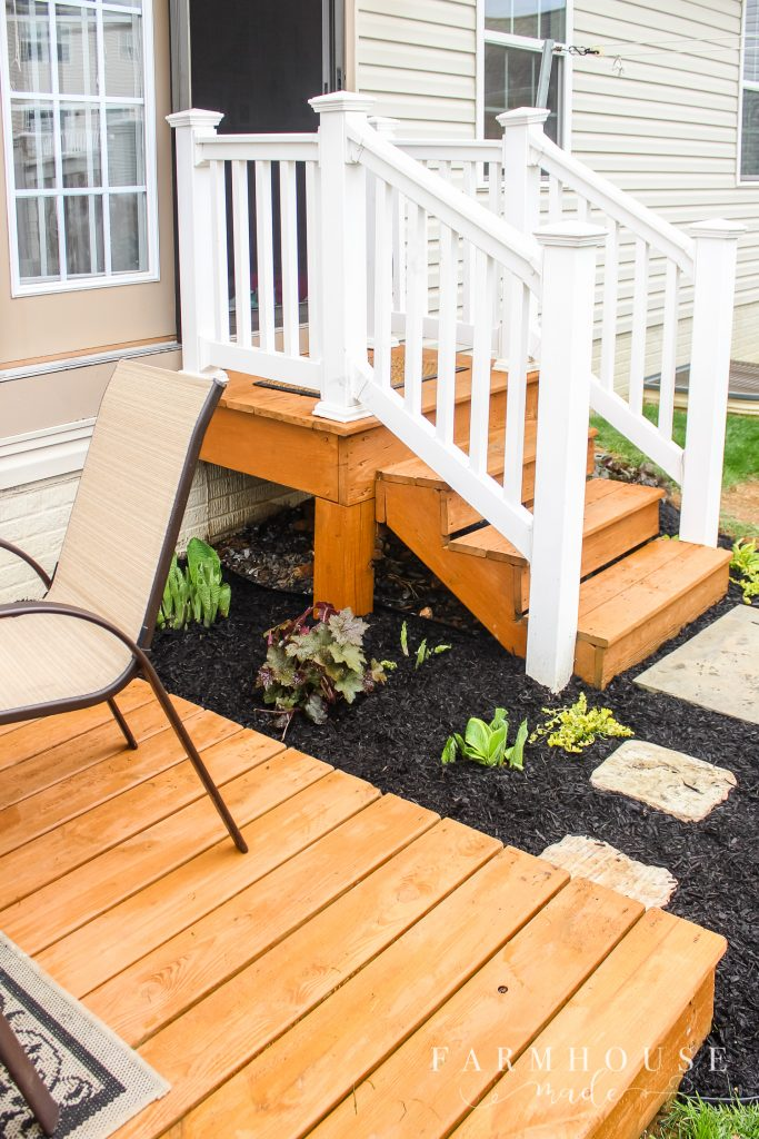 garden with stained deck and steps