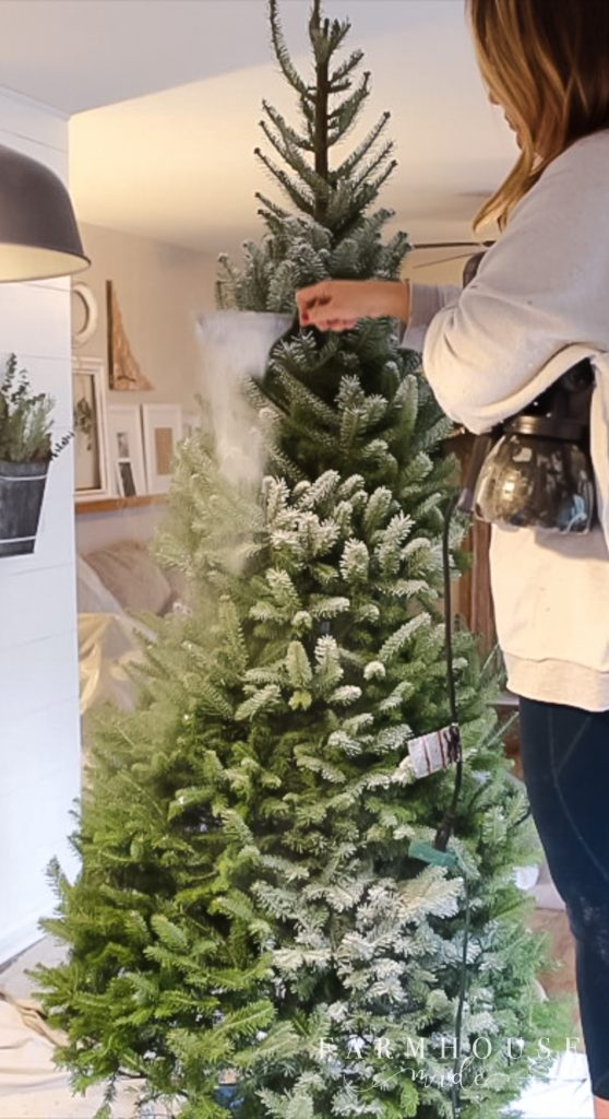 flocking a christmas tree with a paint sprayer
